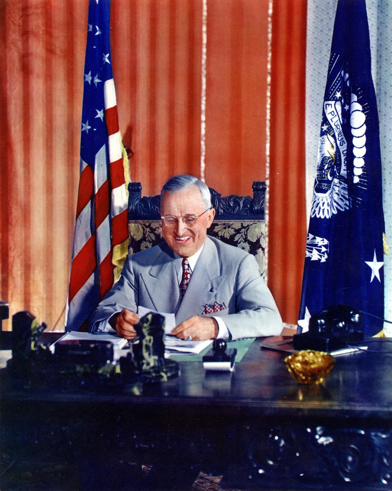 Portrait of President Harry S. Truman at Desk, Grinning