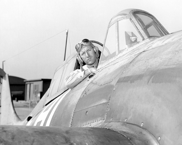 "World War II (WWII) era photograph of US Marine Corps (USMC) Major (MAJ), Edmund F. Overend, taken at San Deigo, California (CA), 1945 as he sits in the cockpit of a US Navy (USN) F4U""CORSAIR""aircraft. MAJ Overend is an Ace Pilot credited with 9 kills. (Exact date shot unknown)"