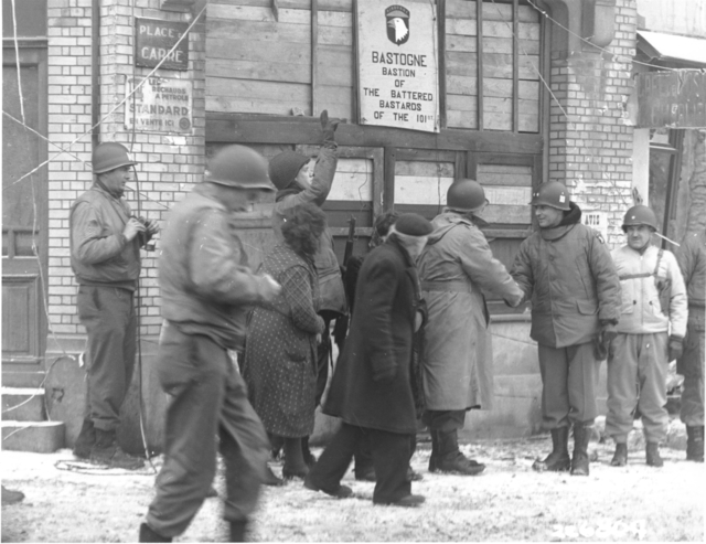 Photograph of Generals of the 101st Airborne Division Reviewing Troops of the 101st Division in Bastogne, Belgium