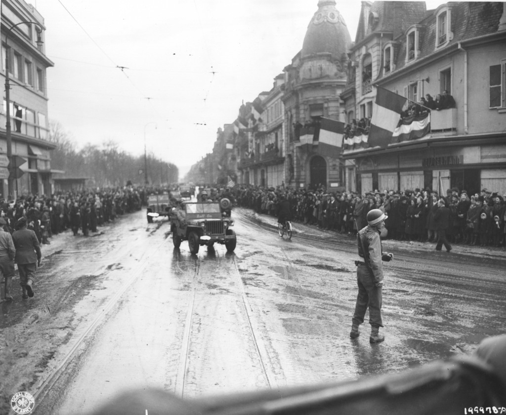 Photograph of Frenchmen Greeting Convoys of the 28th Infantry Division