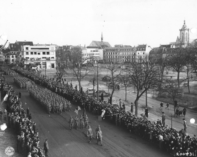 Photograph of the 28th Infantry Division Leading the Color Guard at the Colmar Victory Parade