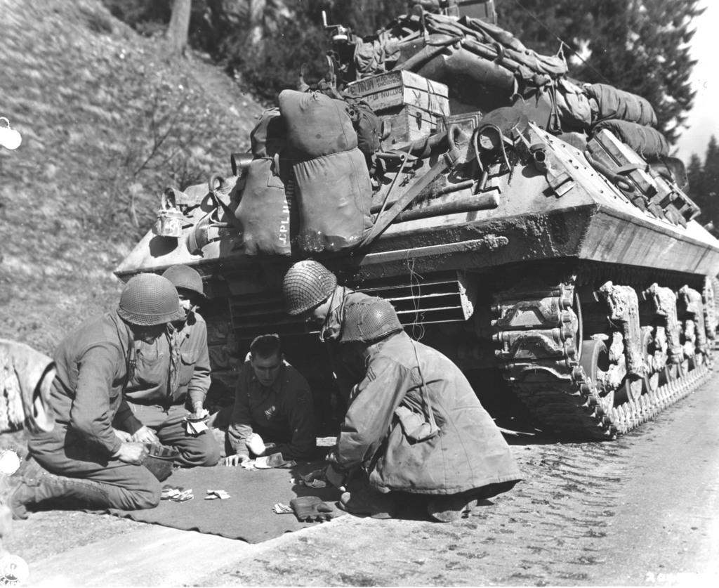 Photograph of a Tank Destroyer Crew Playing Craps While Awaiting Removal of a Road Block