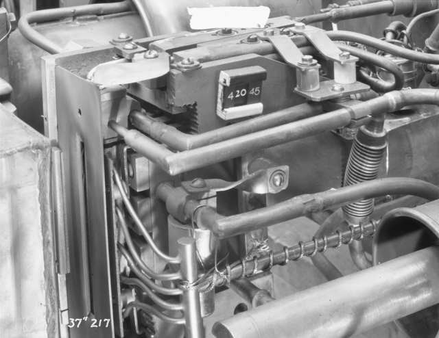"37-inch cyclotron, Phoenix. Heated mercury reservoir with heater manifolds to sputtered block. Photo taken 4/20/1945. 37""-217.  Principal Investigator/Project: Analog Conversion Project"