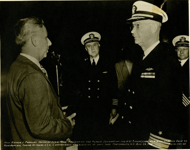 Mayor Arthur J. Frawley of Lynn, Massachusetts, Presents a Plaque to Rear Admiral Thomas Withers