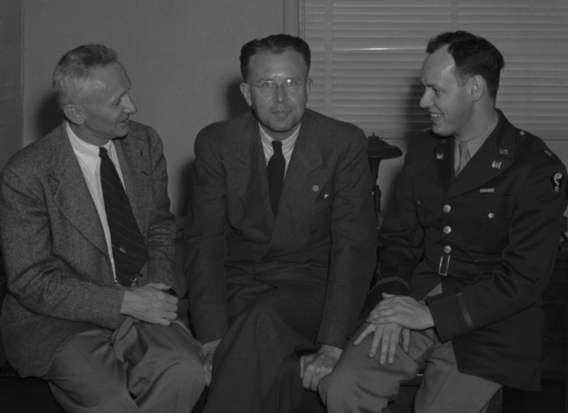 Donald Cooksey, Ernest Orlando Lawrence, and Major Harold A. Fidler. Taken at award ceremony at Lawrence's home, taken October 21, 1945. . See related photo: XBD201008-00913-00916.TIF. Principal Investigator/Project: Analog Conversion Project [Photographer: Donald Cooksey]