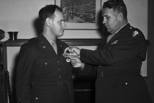 General Leslie R. Groves presenting a medal to Major Harold A. Fidler. Taken at award ceremony at Lawrence's home, taken October 21, 1945. See related photo: XBD201008-00913-00916.TIF. Principal Investigator/Project: Analog Conversion Project [Photographer: Donald Cooksey]
