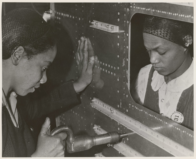 Evelyn T. Gray, Riveter and Pearlyne Smiley, Bucker, Complete a Job on Center Section of a Bomber