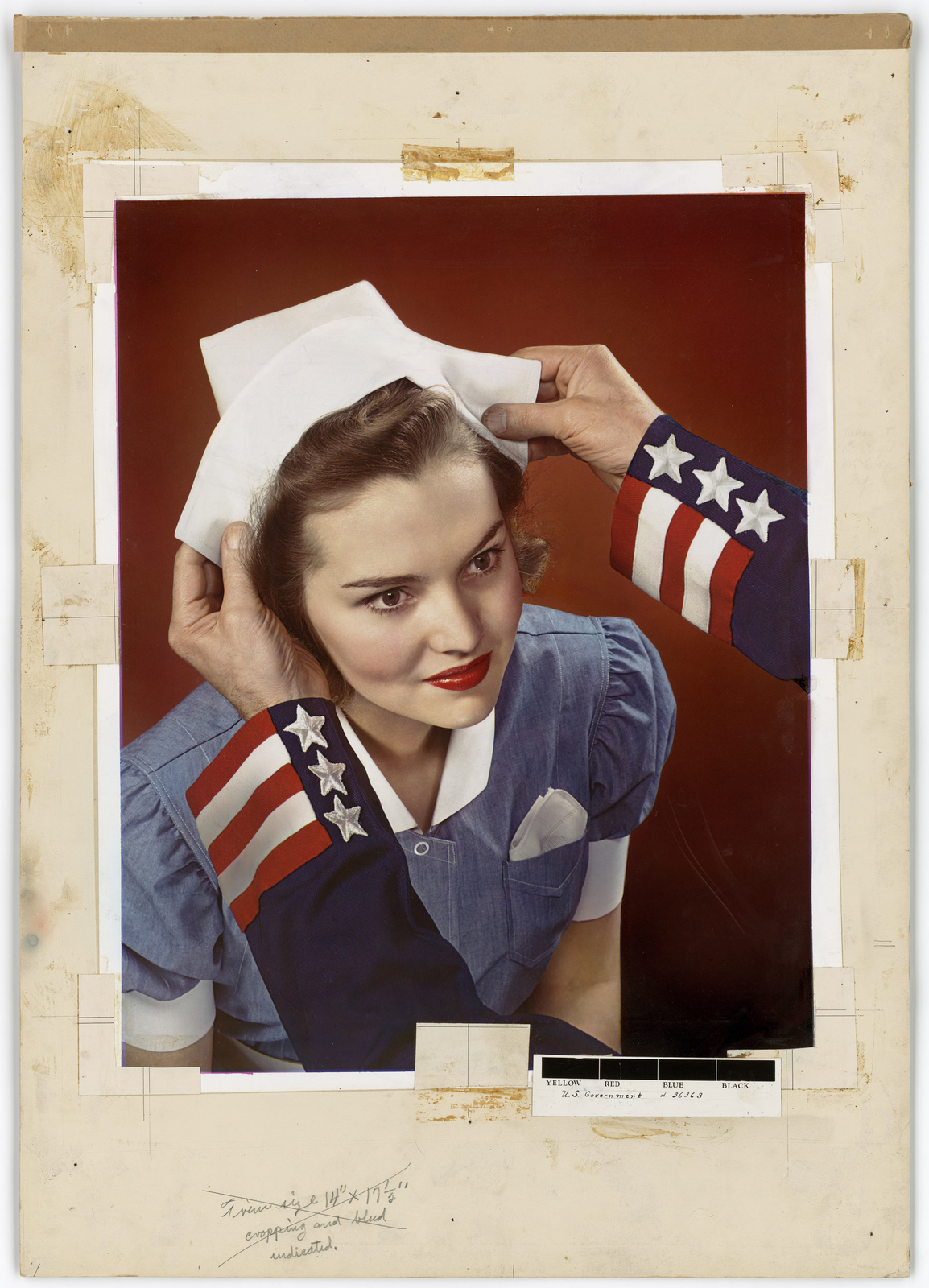 [Nurse having a nurse's cap place on her head] [Victor Keppler]
