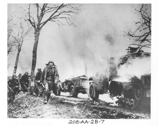 Photograph taken from a Captured German Film Shows German Infantrymen Knocked-Out and Burning American Vehicles