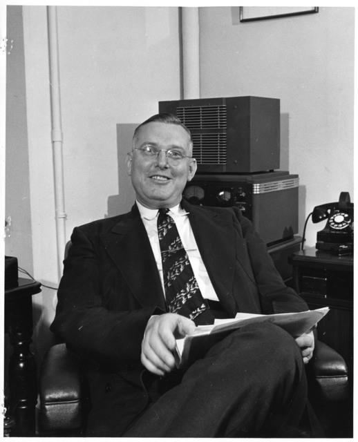 John R. Steelman Smiles for a Photograph