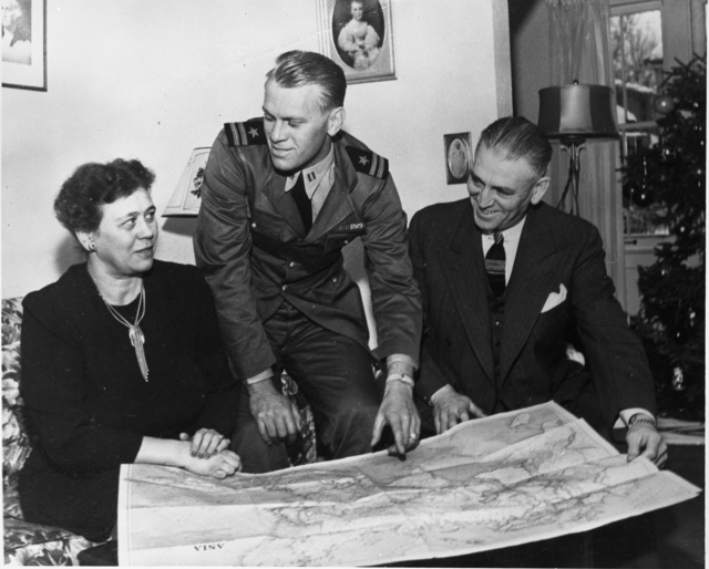 Photograph of Lieutenant Commander Gerald R. Ford, Jr., Showing His Parents a Map of the Pacific Theater after Returning from Active Duty