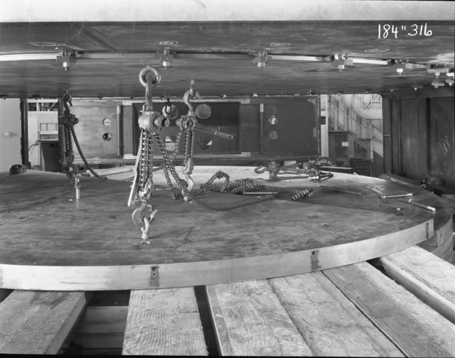 """184-inch cyclotron, calutron conversion, removing plates from roller skids. Photo taken 2/22/1946. 184""""-316 Principal Investigator/Project: Analog Conversion Project"""