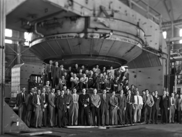 184-inch cyclotron converted from a calutron to a synchrocyclotron in 1945-46. Ernest O. Lawrence and staff posed with the magnet. Photo taken 4/28/1946. Restricted (declassified 4/30/1959). Principal Investigator/Project: Image Library Project