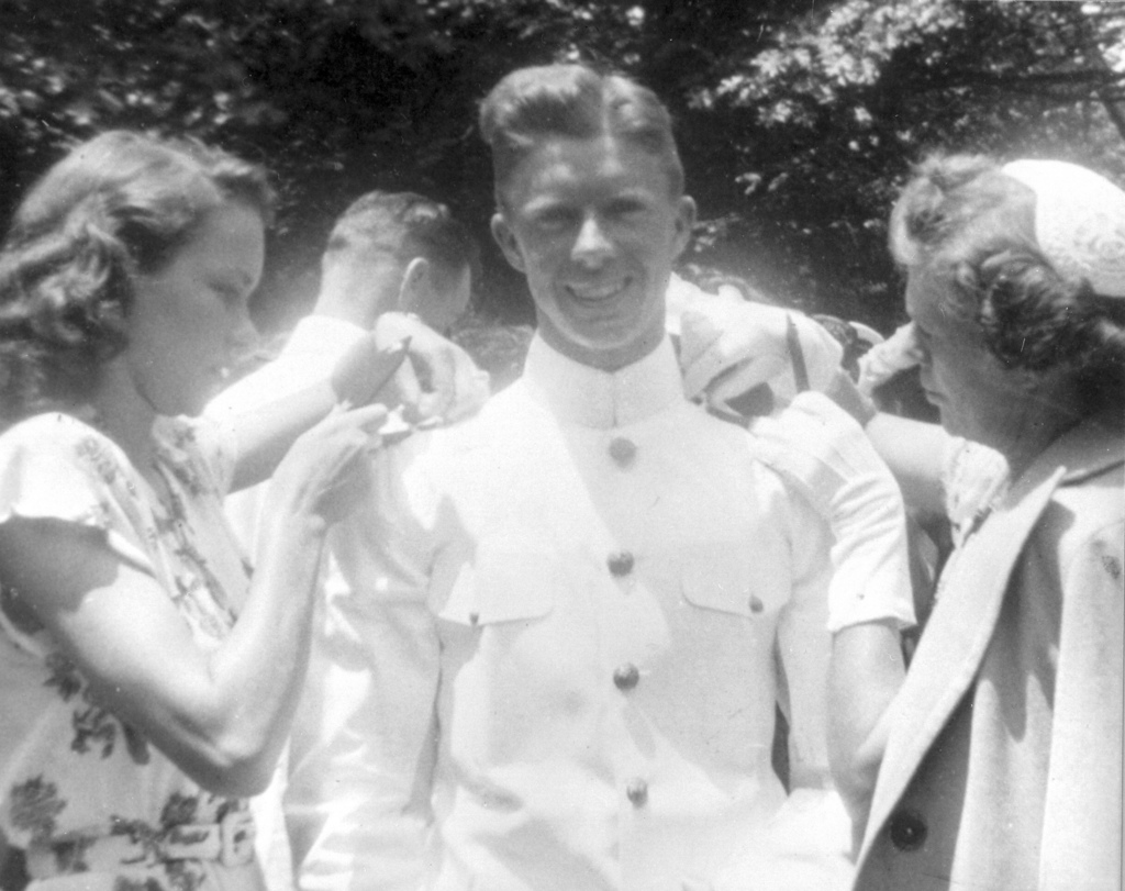 Graduation of Jimmy Carter from U.S. Naval Academy, Annapolis, Maryland, Rosalynn Carter and Lillian Carter Pinning on Ensign Bars