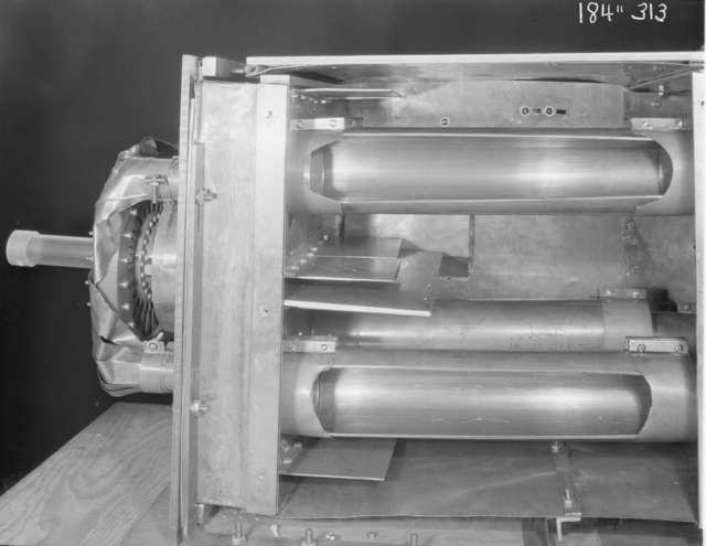 """184-inch cyclotron, calutron conversion, transmission lines and padding capacitors. Photo taken 8/22/1946. 184""""-313 Principal Investigator/Project: Analog Conversion Project"""