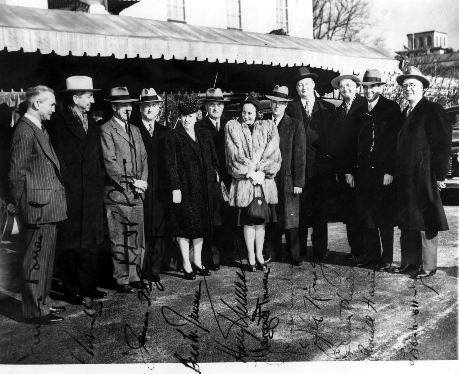 Photograph of President Harry S. Truman with Cabinet and Family Leaving the Capitol
