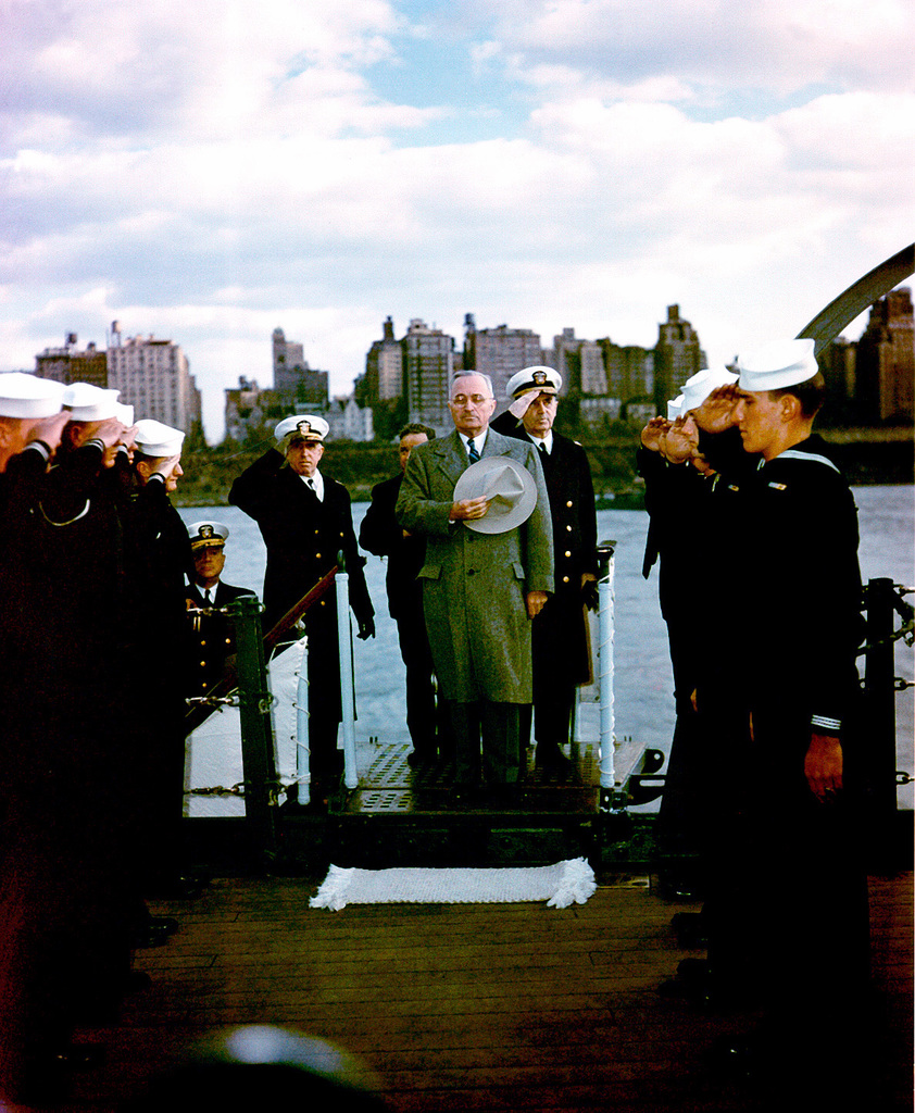 President Harry S. Truman takes a momemt to honor his country and his home state of Missouri before proceeding through the sideboys on board USS Missouri