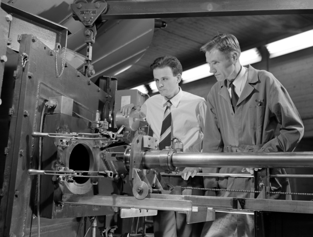 C.M.G. Lattes (left) and E. Gardner with the nuclear emulsion positioning apparatus at the 184-inch cyclotron,1948. Morgue 1948-4 (P-5). Associated with the discovery of machine-made mesons February,1948. Morgue 1948-4 (P-5) [Photographer: Donald Cooksey]