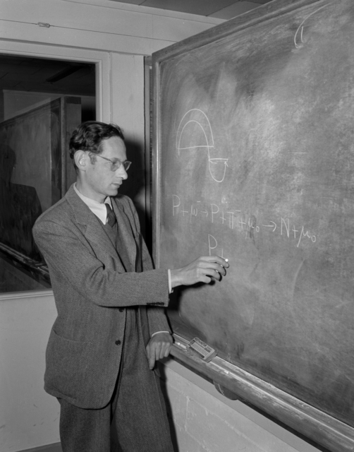 Robert Serber, Laboratory theorist, writing for a photographer shortly after the announcement of the discovery of machine-made mesons by Gardner and Lattes in February 1948. Morgue 1948-3 (P-1) [Photographer: Donald Cooksey]