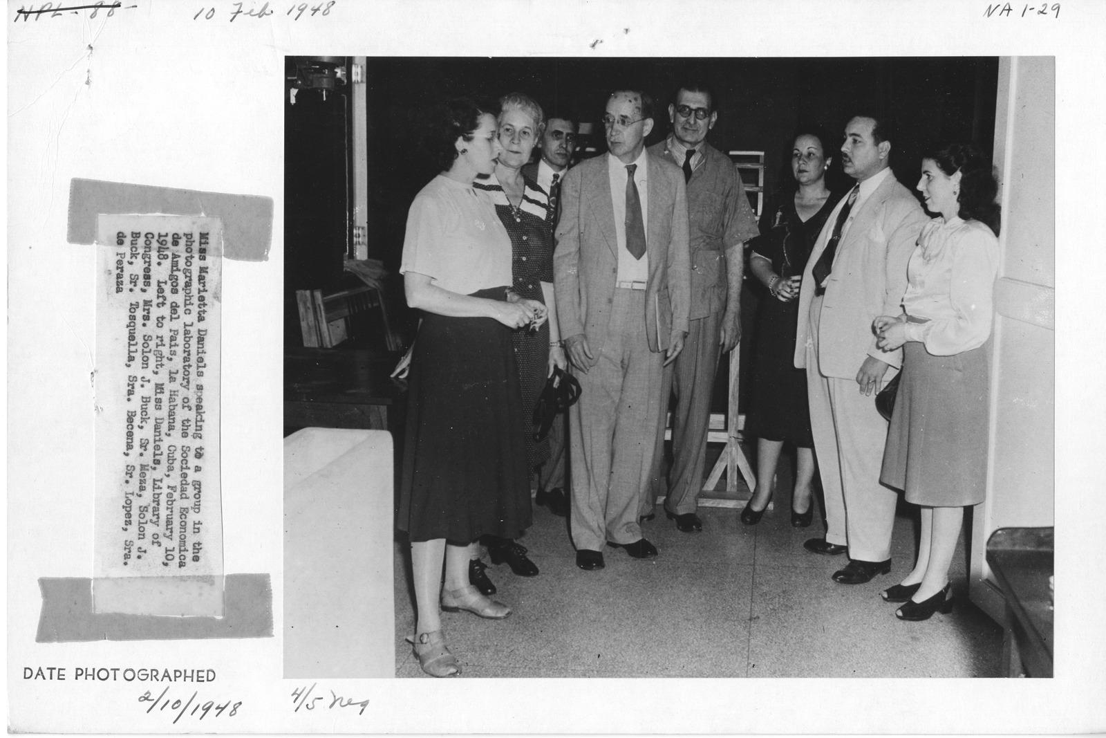 Photograph of Miss Marietta Daniels Speaking to a Group in the Photographic Laboratory of the Sociedad Economica de Amigos del Pats, La Habana, Cuba