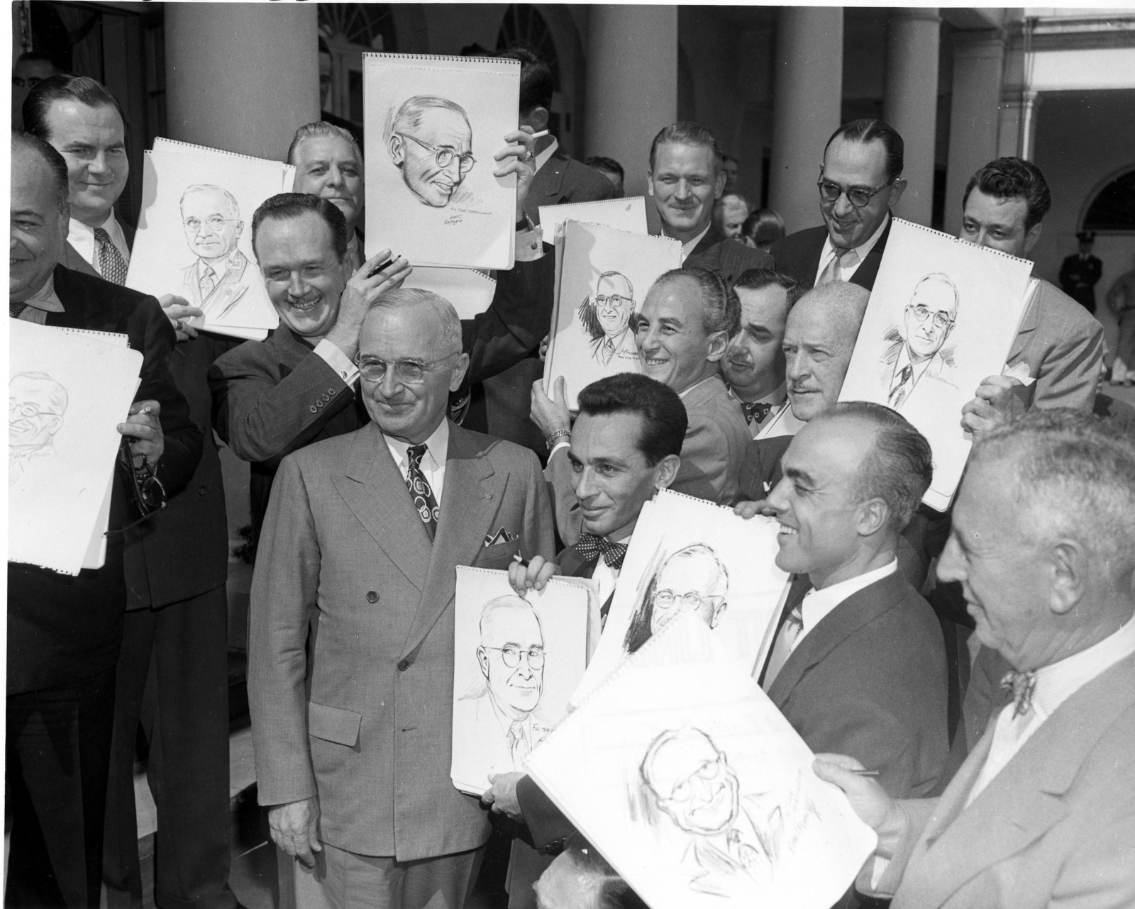 President Harry S. Truman Poses With Completed Cartoon Portraits