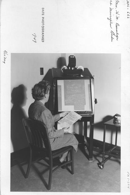 Photograph of Mrs. Hermine M. Baumhofer at Microfilm Reader