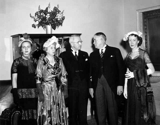 Photograph of the Trumans and Barkleys at an Inaugural Reception