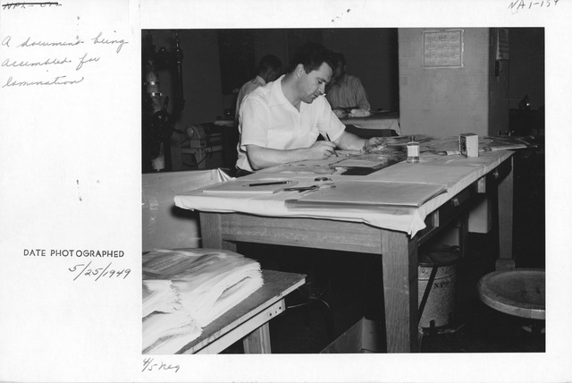 Photograph of Document being Assembled for Lamination