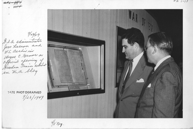 Photograph of General Services Administration (GSA) Administrator Jess Larson and U.S. Archivist, Wayne C. Grover, at the Official Opening of the Freedom Train Exhibit in the National Archives Building