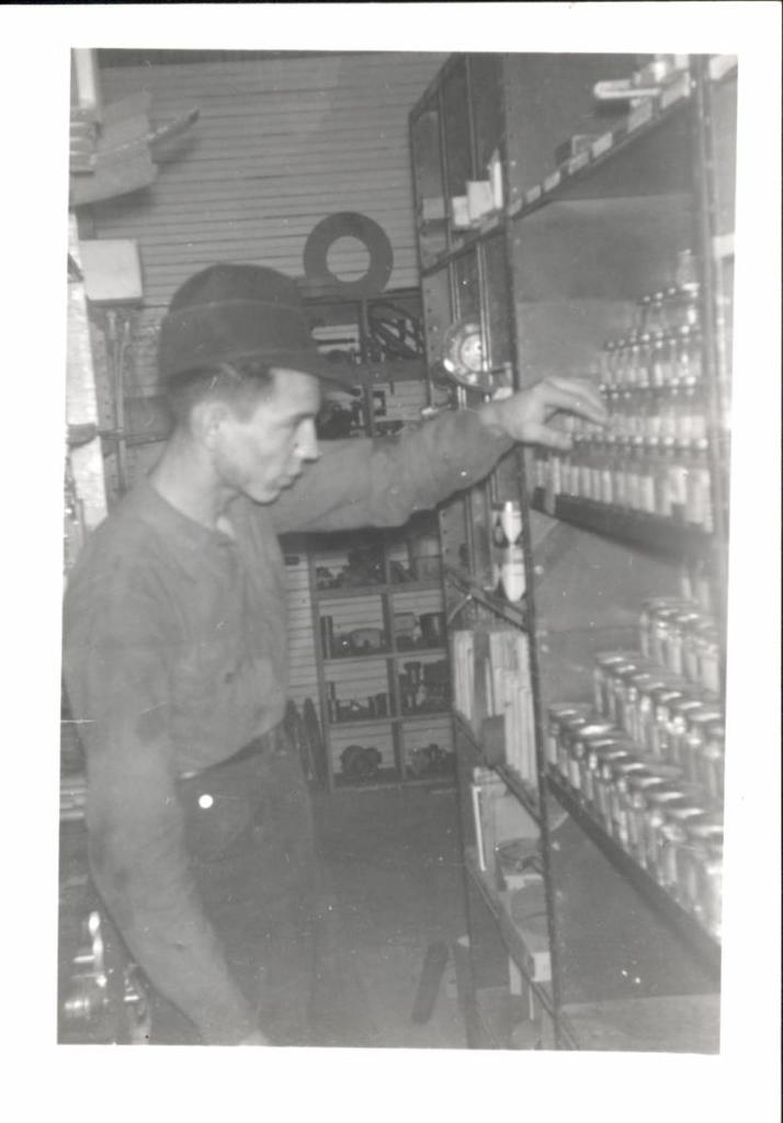 Man Looking at Jars