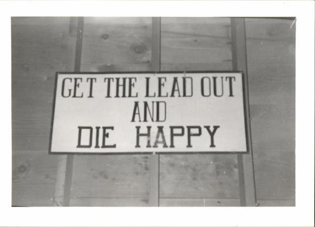 "Sign ""Get the Lead Out and Die Happy"""