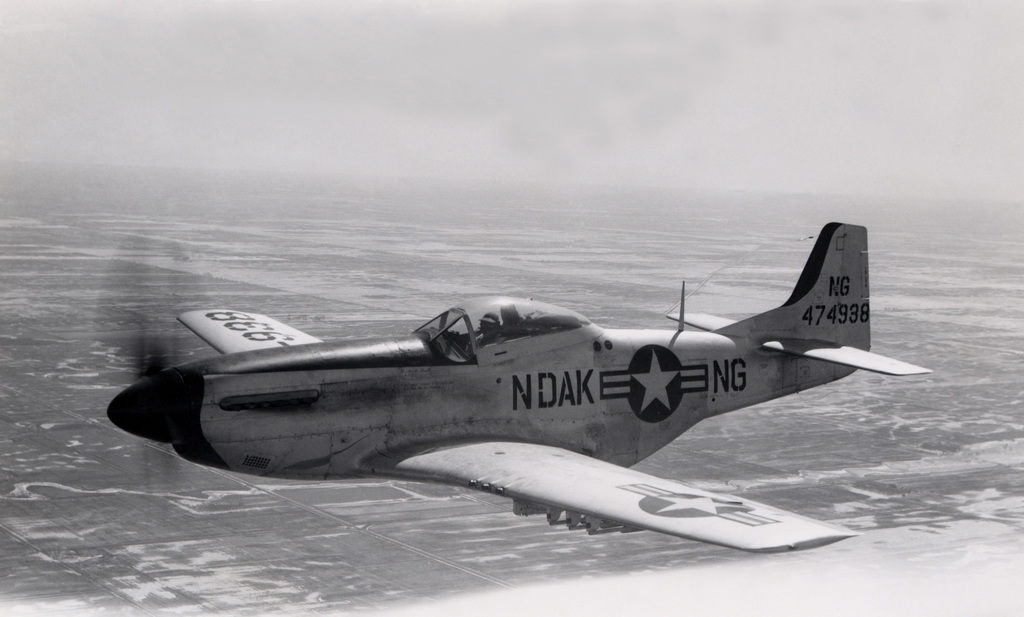 """A U.S. Air Force F-51D Mustang aircraft assigned to the 119th Fighter Wing""""Happy Hooligans"""", 178th Fighter Squadron, North Dakota Air National Guard, in flight near Hector Field, N.D., sometime in early 1950. (A3604) (U.S. Air Force PHOTO) (Released)"""