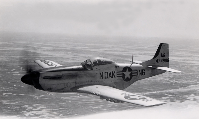 "A U.S. Air Force F-51D Mustang aircraft assigned to the 119th Fighter Wing""Happy Hooligans"", 178th Fighter Squadron, North Dakota Air National Guard, in flight near Hector Field, N.D., sometime in early 1950. (A3604) (U.S. Air Force PHOTO) (Released)"