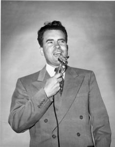 Richard Nixon speaks into a microphone during his Senatorial campaign