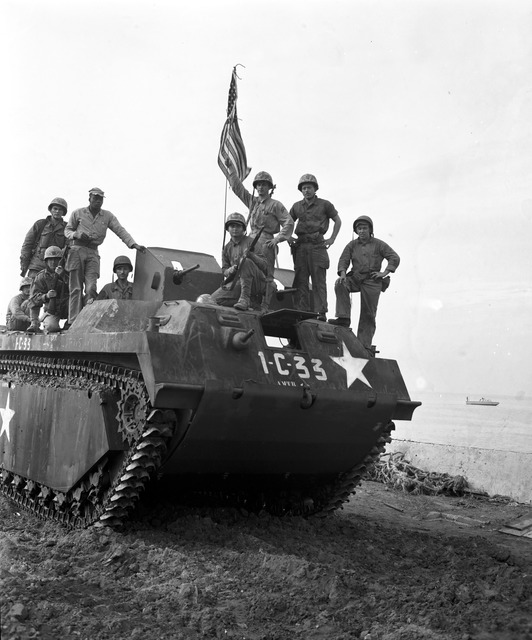 U.S. Marines Come Ashore at Inchon in an Amphibious Tractor, Prepared to Plant the American flag at Seoul. The flag was Given to Them by Col. Lewis B. Puller