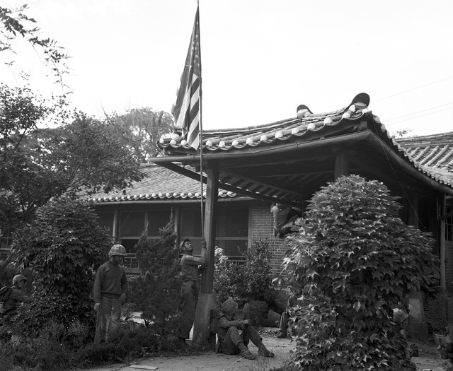 Marine Pfc. Luther R. Loguire, 8903 North Boulevard, Tampa, Florida, Raises U.S. Flag at American Consulate in Seoul, While Fighting for the City Raged Around the Compound