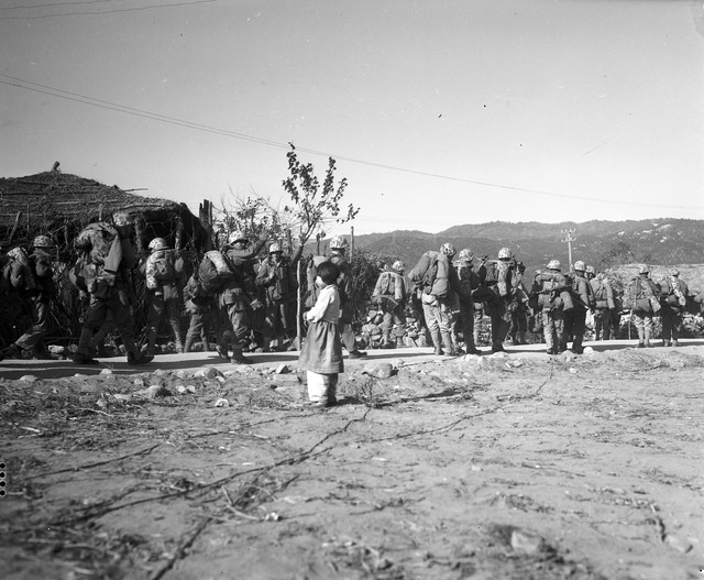 Seventh Marine Regiment, Wearing and Carrying Cold Weather Equipment, Presses into Communist Territory of Chosin Reservoir, Supported by Marine Air Strikes as the Maneuver Progresses