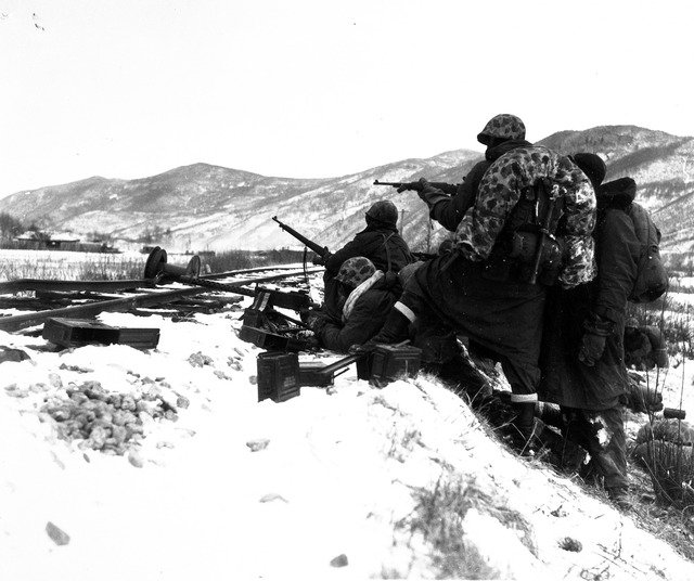 First Division Leathernecks Counter Fire with Fire When Attacked by Well Entrenched Chinese Reds During the Division's Heroic Breakout from Chosin