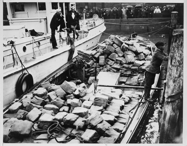 Coast Guardsmen Examine a Haul of Whiskey in New York Harbor