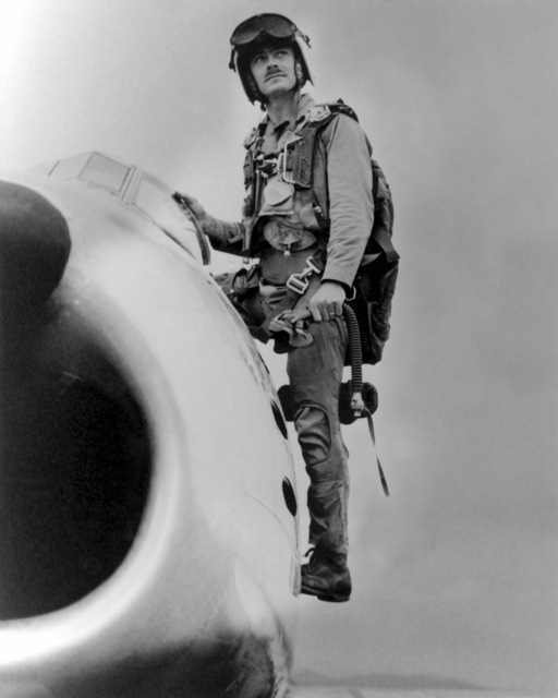 "A Korean War era photograph of US Marine Corps (USMC) Major (MAJ) John F. Bolt, assigned to the 1ST Marine Aircraft Wing, as he exits his USMC F-86""SABER""jet aircraft. MAJ Bolt is the USMC first""Jet Ace""credited with 6 kills, plus he shot down six Japanese planes during World War II (WWII). His hometown is Sanford, Florida.  (Exact date shot unknown)"