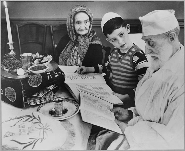 Photograph of a Young Jewish Boy with Elders at a Passover Ceremony