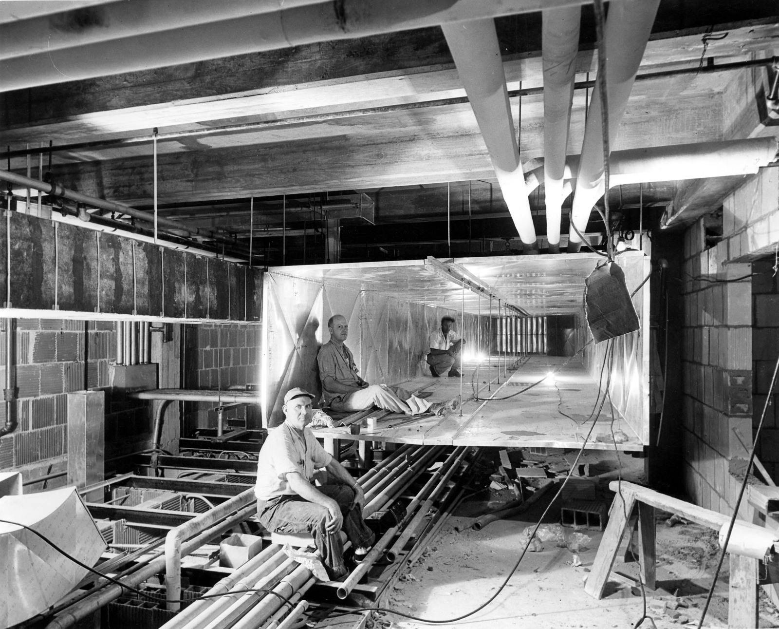 Workers inside Ductwork during the Renovation of the White House
