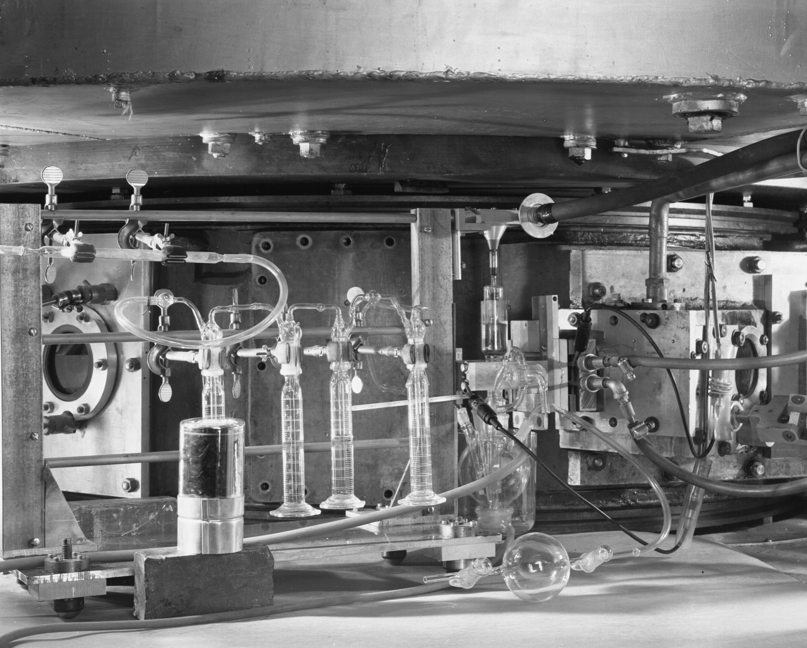 """Rotating glass target for bombardment of aqueous solutions in place on the 60-inch cyclotron. Photo taken 10/04/1951. 60""""-384.  Principal Investigator/Project: Crocker Lab/60-inch"""