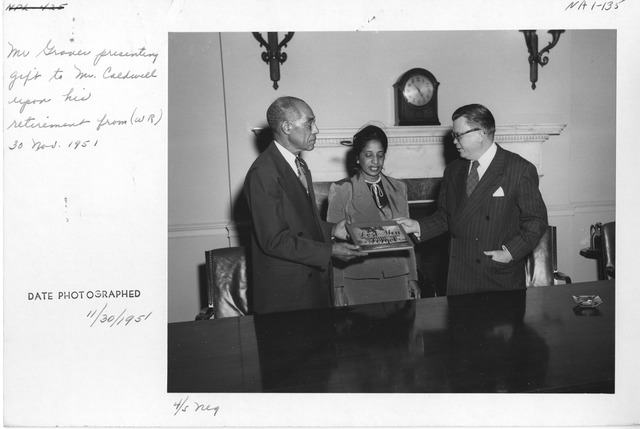 Photograph of Wayne Grover Presenting a Gift to Mr. Hiram O. Caldwell (War Records Branch) upon His Retirement