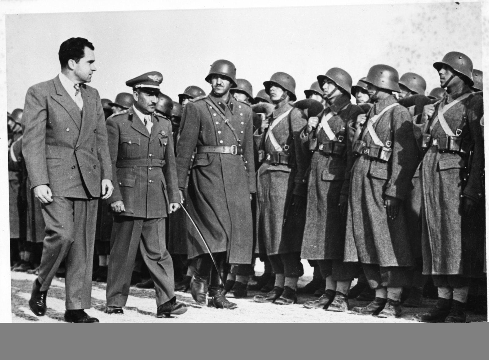 Vice President Richard Nixon reviews an honor guard upon arrival in Kabul