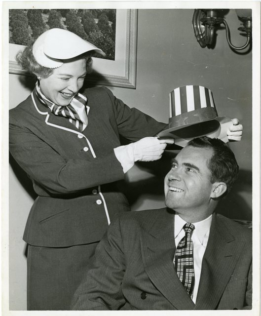 An Uncle Sam hat is placed on Richard Nixon's head during a Lincoln Day dinner