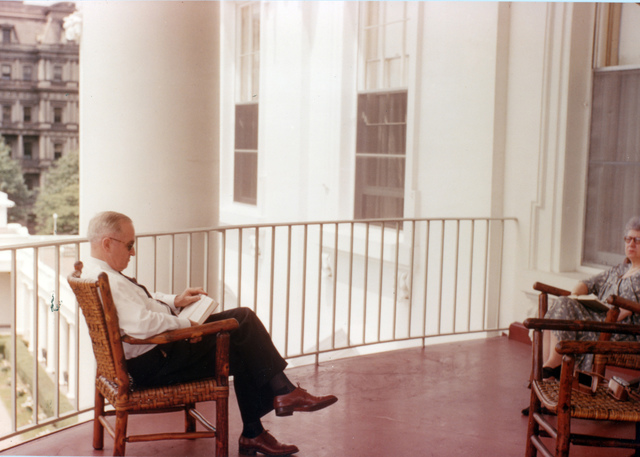 Harry S. Truman Reading on the Balcony of White House