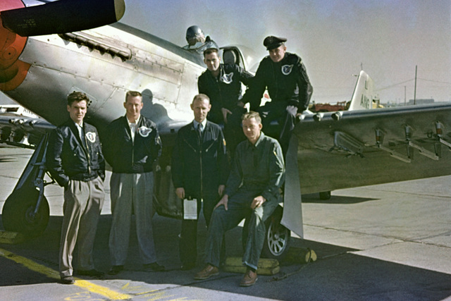"""U.S. Air Force personnel assigned to the 119th Fighter Wing""""Happy Hooligans"""", North Dakota Air National Guard, pose for a photo in front of a F-51D Mustang aircraft, in the early 1950s.  Known identities from right to left in the ground row are Thornton Becklund; Duane""""Pappy""""Larson; and Robert Olwin, far left unknown. Thomas Marking is on the wing on the right. (A3604) (U.S. Air Force PHOTO) (Released)"""