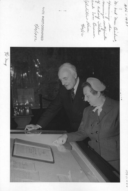 Photograph of M. and Mme. Braibant Examining the Marriage Certificate of Adolf Hitler and Eva Braun