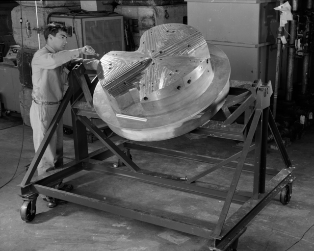 "Partly assembled pole piece. The magnet poles of the very first sector-focused cyclotron, of which the 88"" is a later and grander example. Original photo taken 5/19/52. Principal Investigator/Project: Analog Conversion Project"